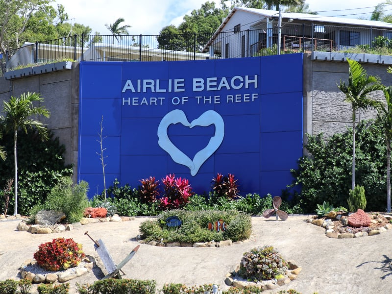 A large sign on the Airlie Beach Main Street