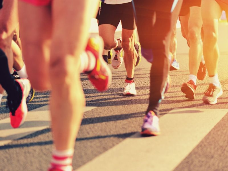 A group of runners racing close up image
