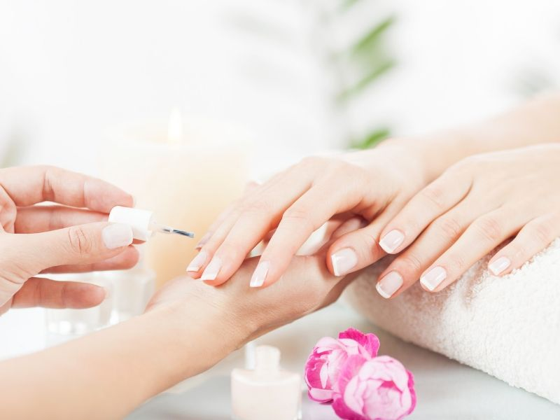 A close up image of a woman getting a manicure