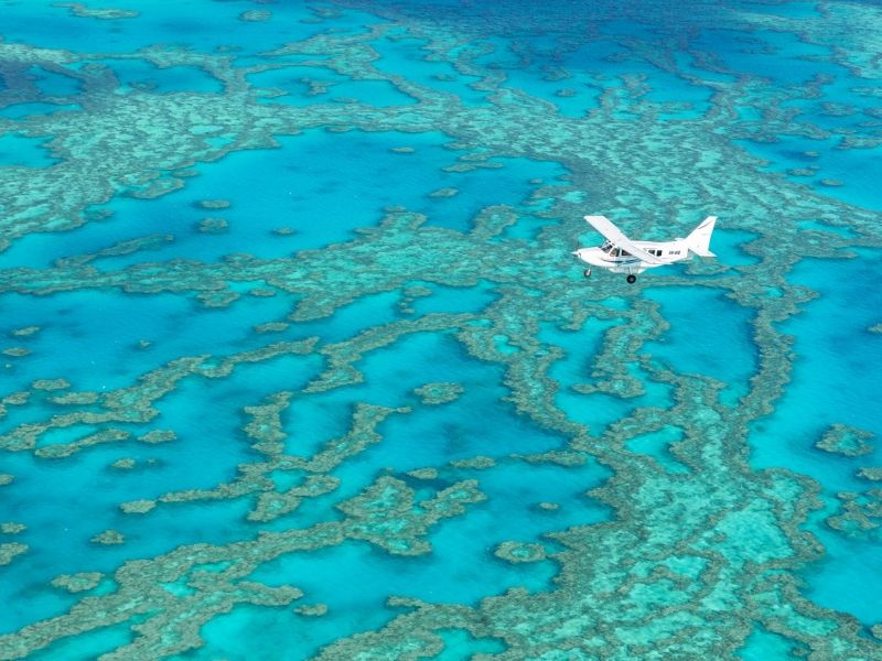 A small plane flying over the outer Great Barrier Reef