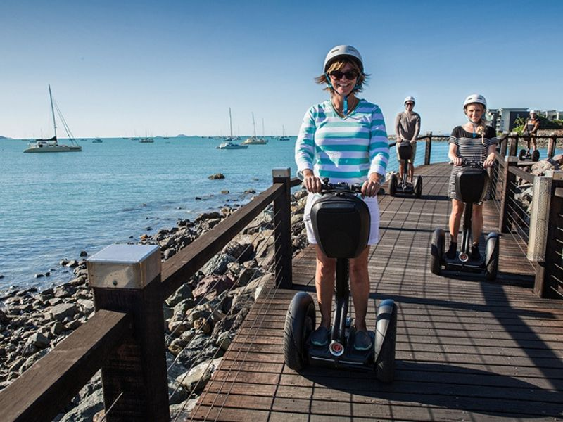 A group enjoying the Whitsunday Segway Tours on the Bicentennial Walkway in Cannonvale