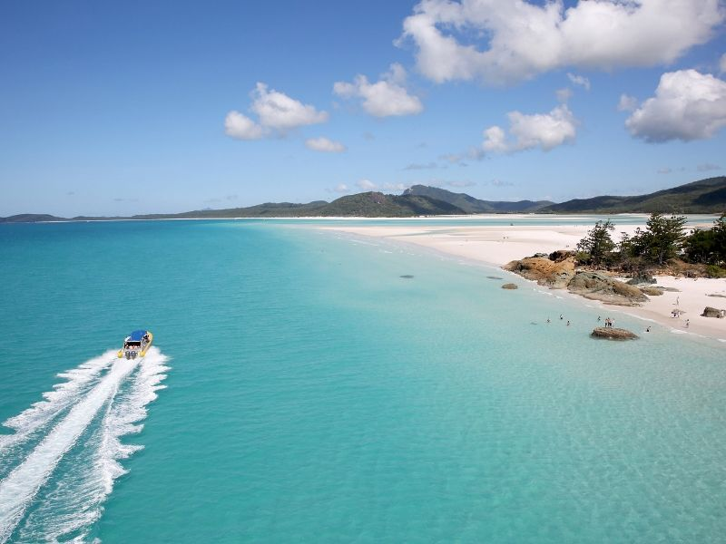 An Ocean Rafting vessel driving past Whitehaven Beach on Whitsunday Island