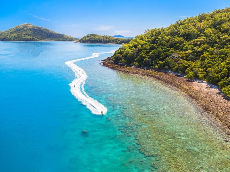 An aerial image of the Whitsunday Jetski Tours in the Whitsundays as a group of people jetski by the islands