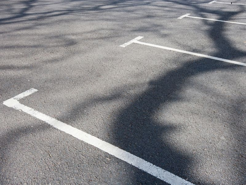 Parking lines painted onto a concrete road