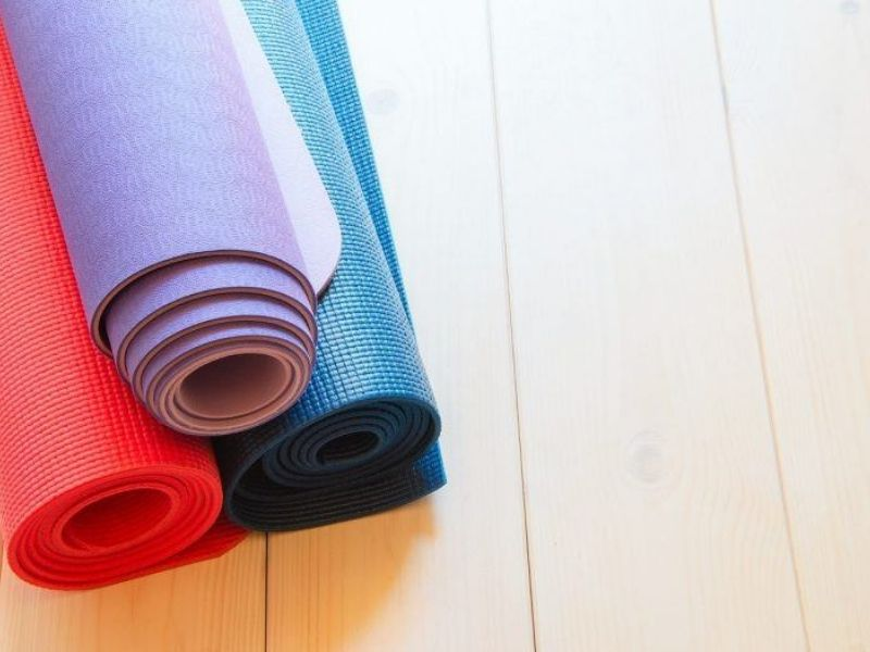 Three yoga matts rolled up and stacked together