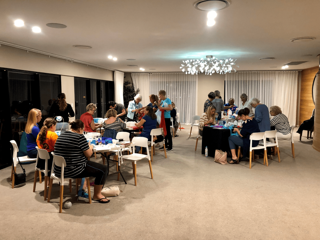 A group of people attending the Coral Sea Academy's Trash to Treasure art workshop in 2019