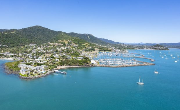 An aerial image of the marina and hotel at the Coral Sea Marina Resort in the Whitsundays