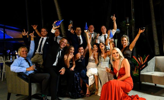 The Red Cat Adventures team celebrating three 2019 Whitsunday Tourism Awards