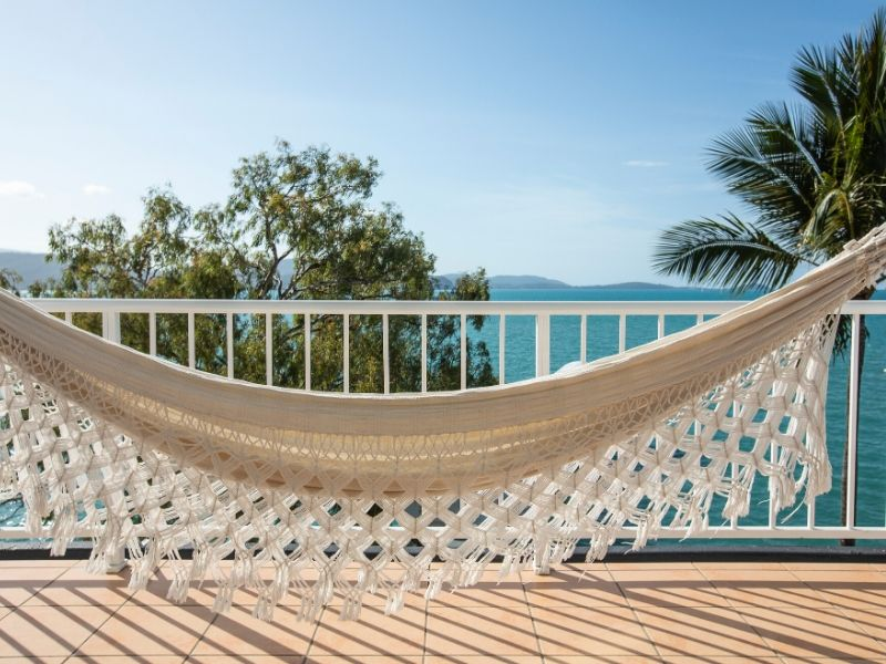 A hammock on the balcony with ocean views at the Coral Sea Resort Hotel