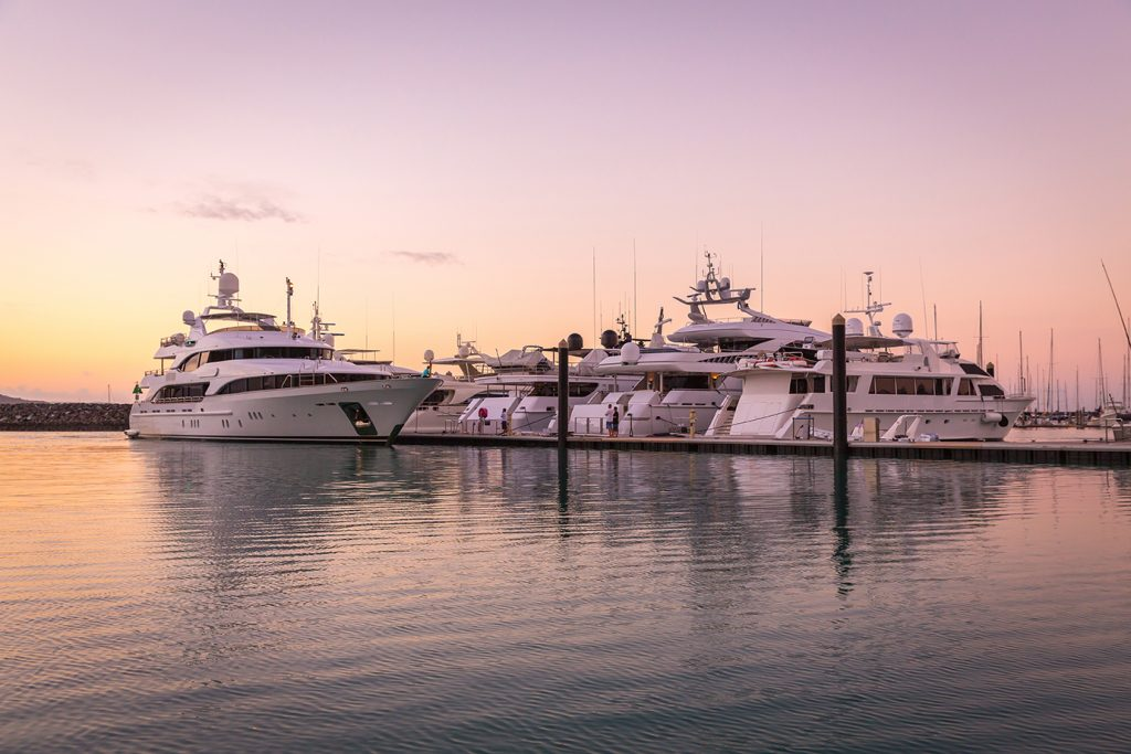 Superyachts at sunset at Coral Sea Marina Resort