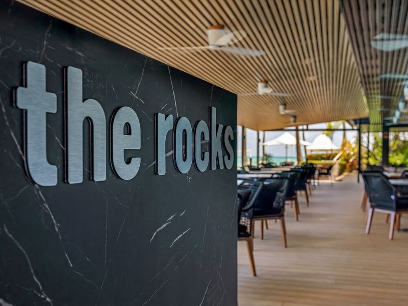 The Rocks Restaurant Bar and Pool Club logo displayed at the entrance to the restaurant