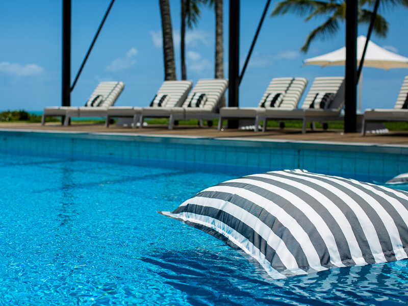 A beanbag floating in the private pool at the Coral Sea Resort Hotel