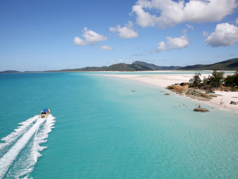 Ocean Rafting vessel driving past Whitehaven Beach in the Whitsundays