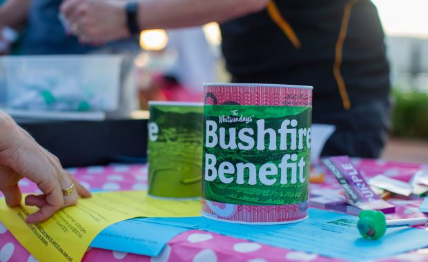 A collection tin on a table at the Whitsundays' Bushfire Benefit at Coral Sea Marina in January 2020.