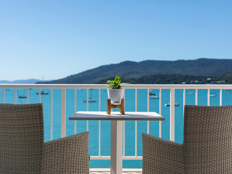 A balcony with ocean views at the Coral Sea Resort Hotel