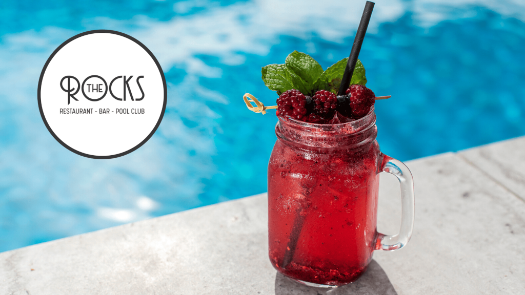 Cocktail by the pool at The Rocks