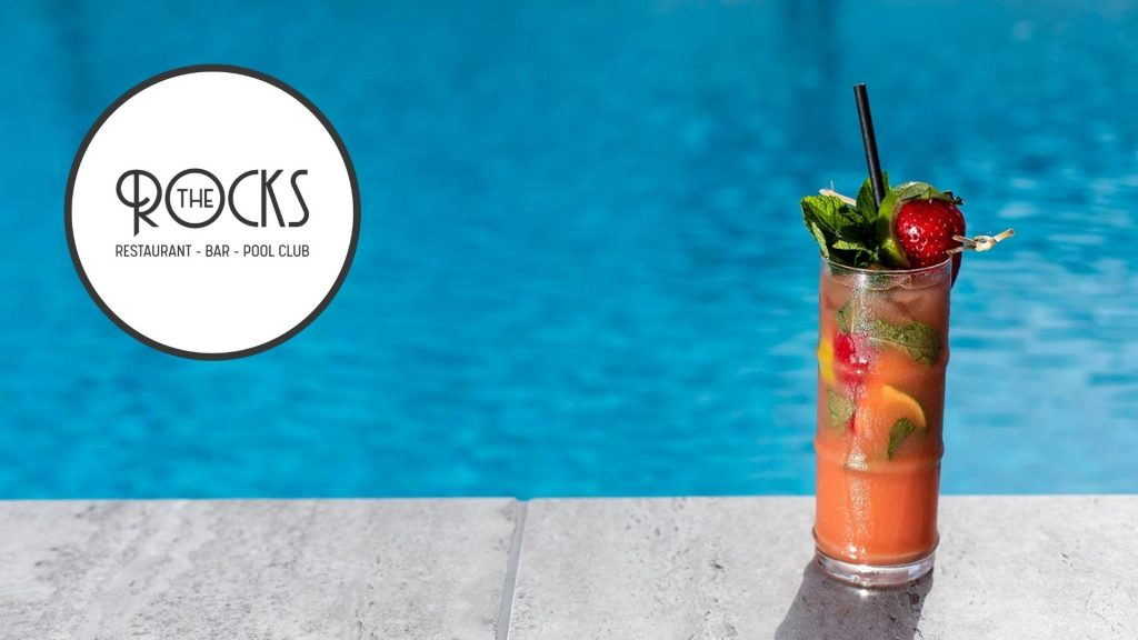A refreshing cocktail by the pool at The Rocks