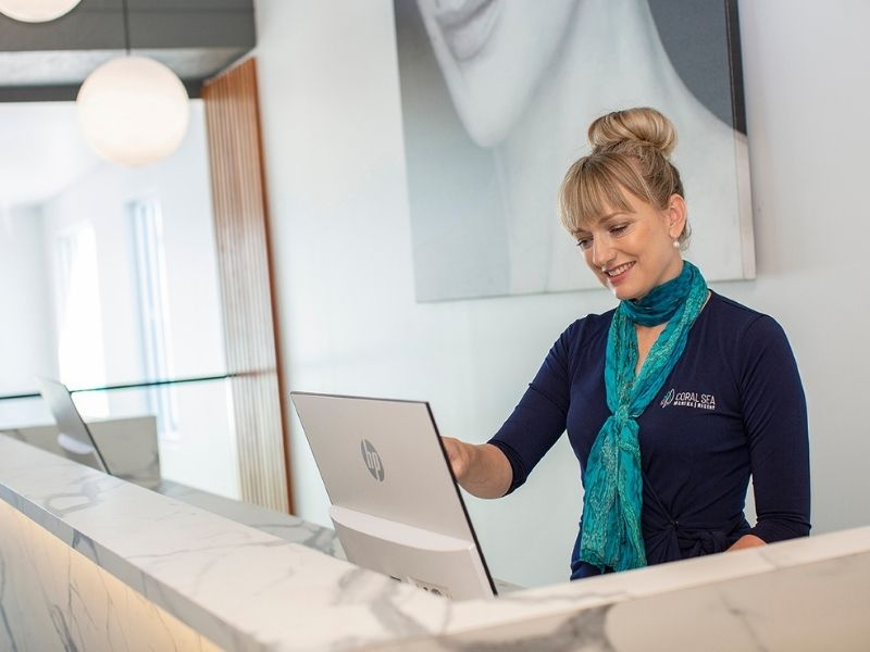 Female receptionist at front desk of Coral Sea Resort Hotel in the Whitsundays